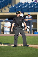 Home plate umpire Steven Jaschinski works the Carolina League game between the Fayetteville Woodpeckers and the Wilmington Blue Rocks at Frawley Stadium on June 6, 2019 in Wilmington, Delaware. The Woodpeckers defeated the Blue Rocks 8-1. (Brian Westerholt/Four Seam Images)