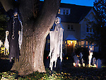 Spooky Halloween decoration. Ghosts and cemetery in the front yard of a house in Toronto, Canada.
