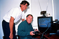 Unknown date: Mark Philippoussis Australia with Coach Tony Roche study form on the Computer
