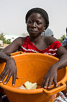Senegal, Touba.  Woman with Cabbage in her Basin, Waiting for a Horse-drawn Taxi to Take her to her Neighborhood.