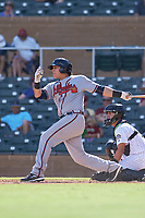 Peoria Javelinas catcher Alex Jackson (22), of the Atlanta Braves organization, follows through on his swing during an Arizona Fall League game against the Salt River Rafters on October 16, 2017 at Salt River Fields at Talking Stick in Scottsdale, Arizona.  Peoria defeated Salt River 6-2.  (Zachary Lucy/Four Seam Images)