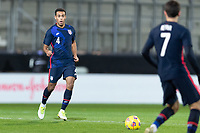 WIENER NEUSTADT, AUSTRIA - : Tyler Adams #4 of the United States moves with the ball during a game between  at Stadion Wiener Neustadt on ,  in Wiener Neustadt, Austria.