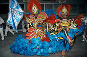 Rio de Janeiro, Brazil. Carnival, Samba school; man and woman standard bearer in blue, red and gold costumes.