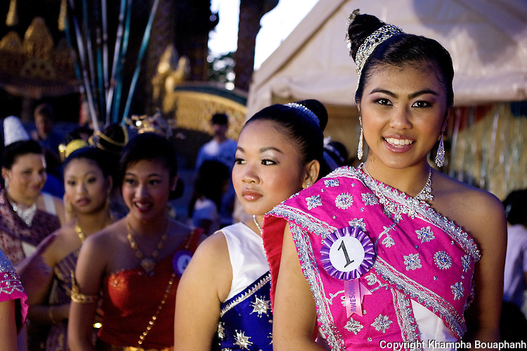 Jessica Le, right, and other contestants for the Miss Songkran pageant prepares to take the stage during the Lao New Year celebration at Wat Lao Thepnimith in Fort Worth on April 24, 2010.  (photo by Khampha Bouaphanh)