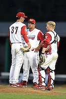 Williamsport Crosscutters pitching coach Aaron Fultz (46) talks with pitcher Brandon Leibrandt (37) and catcher Sean McHugh (21) during a game against the Aberdeen IronBirds on August 4, 2014 at Bowman Field in Williamsport, Pennsylvania.  Aberdeen defeated Williamsport 6-3.  (Mike Janes/Four Seam Images)
