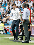 Real Madrid's coach Jose Mourinho (r) and Valencia's coach Mauricio Pellegrino have words during La Liga match.August 19,2012. (ALTERPHOTOS/Acero)