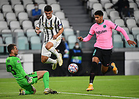 Football Soccer: UEFA Champions League -Group Stage-  Group G - Juventus vs FC Barcellona, Allianz Stadium. Turin, Italy, October 28, 2020.<br /> Juventus Alvaro Morata (c) in action with Barcellona's goalkeeper Neto (l) and Ronald Araujo (r) during the Uefa Champions League football soccer match between Juventus and Barcellona at Allianz Stadium in Turin, October 28, 2020.<br /> UPDATE IMAGES PRESS/Isabella Bonotto