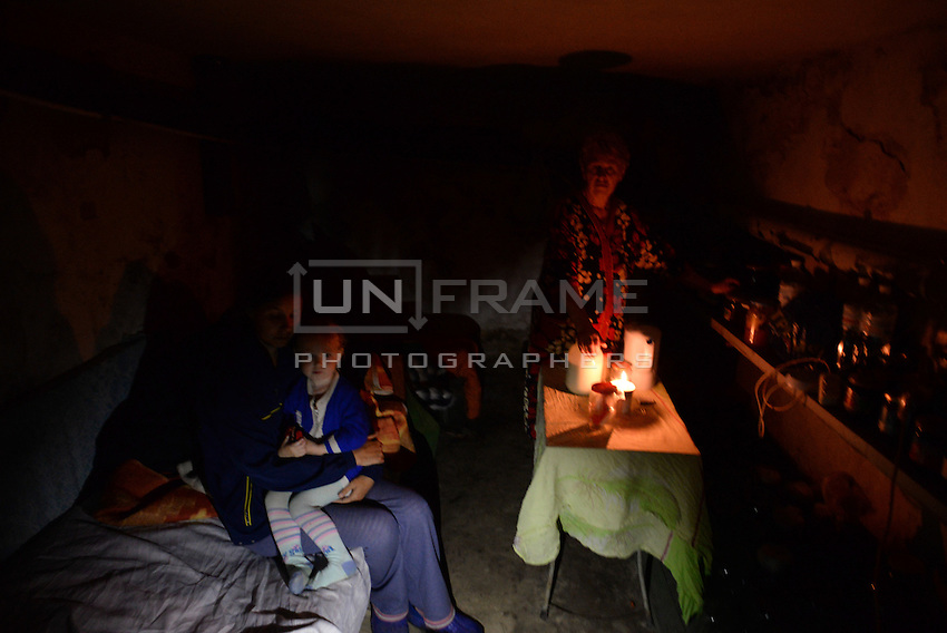 Slovyansk. Familly hides in the basement turned into shelter from shelling.
