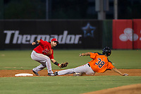 AZL Angels shortstop Stephen Kerr (16) tags out AZL Giants designated hitter Aaron Bond (38) during a game against the AZL Giants on July 9, 2017 at Diablo Stadium in Tempe, Arizona. AZL Giants defeated the AZL Angels 8-4. (Zachary Lucy/Four Seam Images)