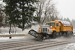Snow plow clearing the road