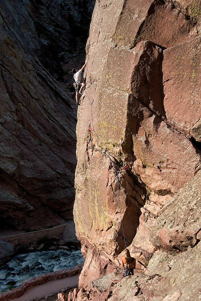Caucasian man and woman rock climbing the West Buttress Route on the Bastille rock formation in Eldorado Canyon, Boulder, Colorado. .  John leads private photo tours in Boulder and throughout Colorado. Year-round.