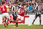 Juventus' player Paulo Dybala contests the ball against South China's player Sean Tse Ka Keung and South China's player Mahama Awai during the South China vs Juventus match of the AET International Challenge Cup on 30 July 2016 at Hong Kong Stadium, in Hong Kong, China.  Photo by Marcio Machado / Power Sport Images