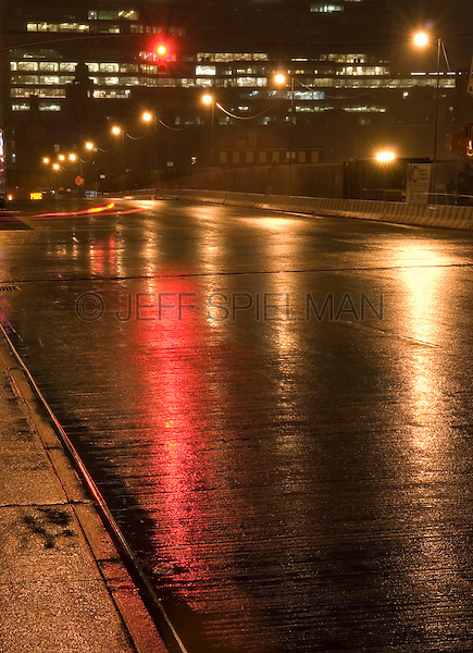 AVAILABLE FROM JEFF AS A FINE ART PRINT.<br /> <br /> AVAILABLE FROM JEFF FOR COMMERCIAL AND EDITORIAL LICENSING.<br /> <br /> Mysterious Rainy Street Scene at Night with Red Traffic Light, The Far West Side of Midtown Manhattan, New York City, New York State, USA