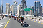 The peloton passes through Dubai city during Stage 6 of the 2021 UAE Tour running 165km from Deira Island to Palm Jumeirah, Dubai, UAE. 26th February 2021.<br /> Picture: LaPresse/Fabio Ferrari   Cyclefile<br /> <br /> All photos usage must carry mandatory copyright credit (© Cyclefile   LaPresse/Fabio Ferrari)