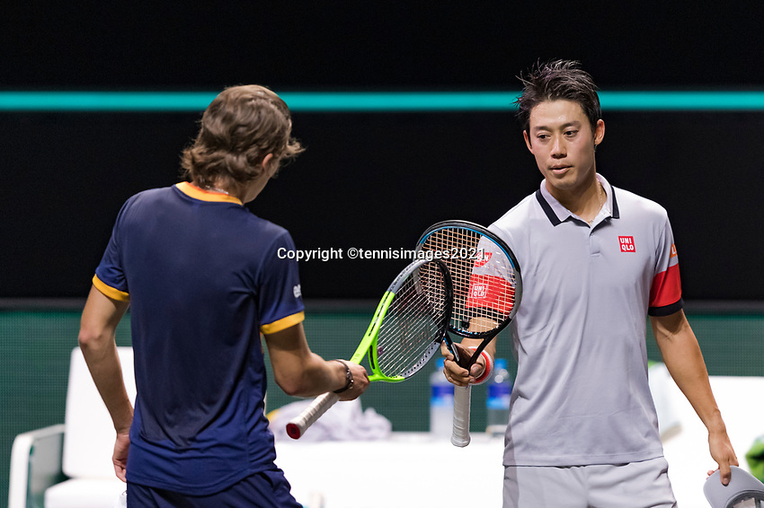 Rotterdam, The Netherlands, 3 march  2021, ABNAMRO World Tennis Tournament, Ahoy, First round singles: Kei Nishikori (JPN) Alex De Minaur (AUS) handshake.<br /> Photo: www.tennisimages.com/henkkoster