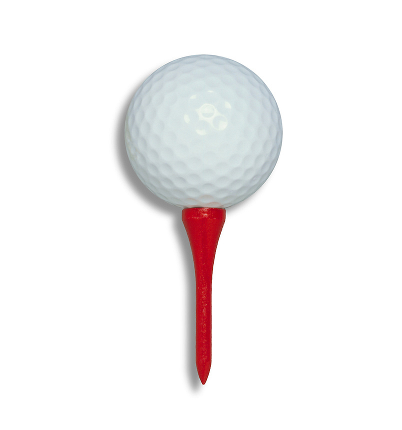 White golf ball on red golf tee.