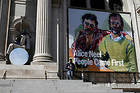 NEW YORK, NEW YORK - MARCH 19: A man check his phone in front of The Met Museum on March 19, 2021 in New York. The Met Museum is considering selling some of its works to support itself after claming that the pandemic has caused a loss of revenue of $150 million in about 18 months. (Photo by John Smith/VIEWpress)