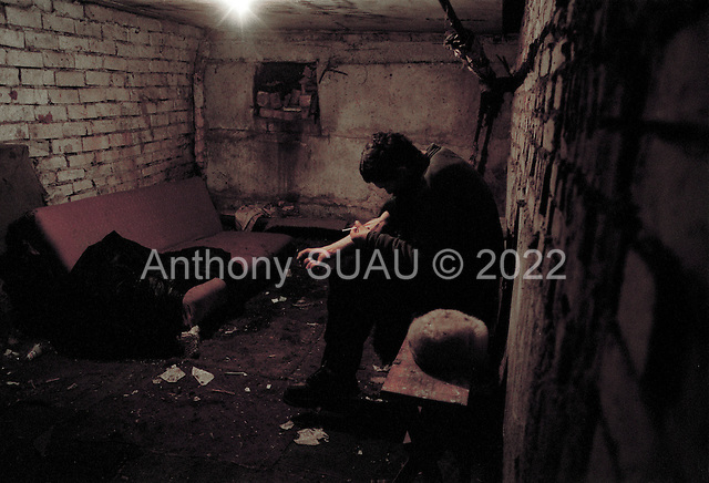 Tolyatti, Russia..Slava is a confirmed HIV infected heroine junky and is seen here shooting up in the basement of an appartment building.
