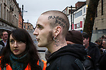 """© Joel Goodman - 07973 332324 - all rights reserved . 20/03/2010 . Bolton , UK . A man with a tattoo that reads """" Manchester Punx """" on his head . The English Defence League ( EDL ) hold a demonstration in Bolton , opposed by Unite Against Fascism ( UAF ) . Photo credit : Joel Goodman"""