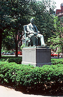Boston:  Statue of Wm. Lloyd Garrison, an abolitionist.  Bronze and granite sculpture by Olin L. Warren, 1886,  in center strip, Commonwealth Ave., Back Bay.  Photo '88.