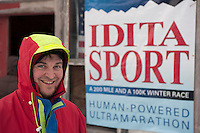 Race Director Billy Koitzsch in front of the headquarters of the 200-mile Iditasport Human Powered Race in Knik, Alaska.  Koitzsch organized the 2014 event as a revival of the legendary 1980's race, which was the first of its kind to put foot and bicycle power to the test against a trail normally only traversed by dogsled or snowmachine. The original competition paved the way for other endurance races in the far north and spurred a number of innovations in outdoor equipment, including the now-ubiquitous fat tire bicycle.