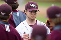 Nick Petree (10) of the Missouri State Bears fist bumps teammates on his way back to the dugout during a game against the Northwestern Wildcats at Hammons Field on March 8, 2013 in Springfield, Missouri. (David Welker/Four Seam Images)