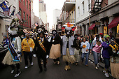 New Orleans, Louisiana.February 27, 2006..The King and Queen of the Zulu Socisl aid and Pleasure Club arrive to Mardi Gras by boat and are greeted by New Orleans Mayor C. Ray Nagin...Zulu members march through the French Quarter.
