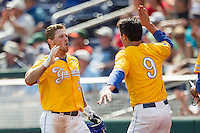 UC Santa Barbara Gauchos designated hitter Ryan Cumberland (31) is greeted by teammate JJ Muno (9) after scoring against the Miami Hurricanes in Game 5 of the NCAA College World Series on June 20, 2016 at TD Ameritrade Park in Omaha, Nebraska. UC Santa Barbara defeated Miami  5-3. (Andrew Woolley/Four Seam Images)