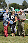 25 Apr 2009: A representative of Augustin Stables (l) accepts the trophy for Flight Briefing's win in the Embarq Sport of Kings Maiden Hurdle at the Foxfield Races in Charlottesville, Virginia.
