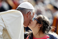 Papa Francesco bacia una bambina al suo arrivo all'udienza generale del mercoledi' in Piazza San Pietro, Citta' del Vaticano, 6 aprile 2016.<br /> Pope Francis kisses a child as he arrives to attend his weekly general audience in St. Peter's Square at the Vatican, 6 April 2016.<br /> UPDATE IMAGES PRESS/Isabella Bonotto<br /> <br /> STRICTLY ONLY FOR EDITORIAL USE