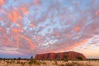 Uluru is the worlds largest monolith.  The size only becomes apparent when you try to walk around it on a 100+ degree day.  I was originally named Ayers Rock but is now officially known as Uluru.  Certainly it is Australia's best know natural landmark.