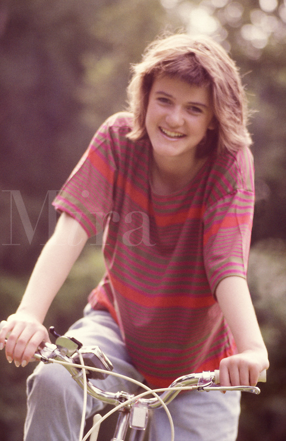 Girl, 14 years old, on bicycle.
