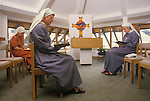 Nuns in the chapel at Martin House Hospice provides family-led care and support for children and young people with life-limiting conditions. 1990s UK