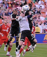 Toronto FC goalkeeper Stefan Frei (24) jump to get possession of the ball against DC United midfielder Rodney Wallace (22).    DC United tied Toronto FC. 3-3 at  RFK Stadium, Saturday May 9, 2009.