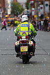 © Joel Goodman - 07973 332324 . 19/06/2011 . Manchester , UK . A motorcycle police officer sprays bubbles from the back of his bike . Thousands of Mancunians line the streets of Manchester City Centre to watch the annual Manchester Day Parade, which celebrates Manchester life and culture . Photo credit : Joel Goodman
