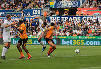 11th September 2021; Swansea.com Stadium, Swansea, Wales; EFL Championship football, Swansea versus Hull City; Rhys Williams of Swansea City and Jacob Greaves of Hull City challenge for the ball