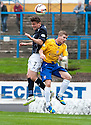 Dundee's Nicky Riley and Cowdenbeath's Marc McKenzie challenge for a high ball.