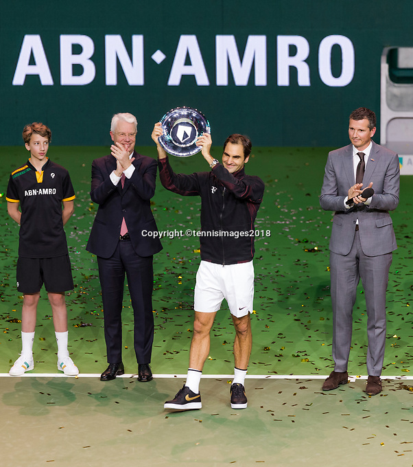 Rotterdam, The Netherlands, 18 Februari, 2018, ABNAMRO World Tennis Tournament, Ahoy, Singles final, Winner Roger Federer (SUI) with the trophy, right tournament director Richard Krajicek and left the CEO from the ABNAMRO Bank Kees van Dijkhuizen<br /> <br /> Photo: www.tennisimages.com