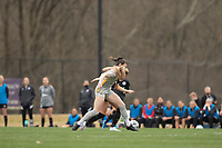 LOUISVILLE, KY - MARCH 13: Jordan Brewster #10 of West Virginia University and Cece Kizer #5 of Racing Louisville FC battle for possession during a game between West Virginia University and Racing Louisville FC at Thurman Hutchins Park on March 13, 2021 in Louisville, Kentucky.