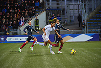Lorient, France. - Sunday, February 8, 2015:  Christen Press (23) of the USWNT is defended by Laura Georges (4) of France. France defeated the USWNT 2-0 during an international friendly at the Stade du Moustoir.