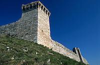 Stone walls of the Rocca Maggiore, Assisi, Italy.