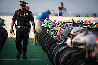A police officer patrols the transition area at the 2013 Ironman World Championship in Kailua-Kona, Hawaii on October 12, 2013.
