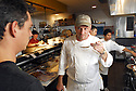 Chef Donald Link tastes some sauce at Cochon, a hot new restaurant in New Orleans, May 4, 2006..(Cheryl Gerber for New York Times)..