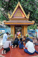 Cambodia, Siem Reap.  Worshipers at Shrine to Ya Tep, a Spirit (Neak-Ta) Who Brings Protection.