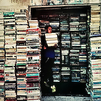 A Salvadorean book vendor carries a pile of books to sell them outdoors on the street of San Salvador, 12 February 2014.