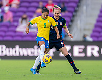 ORLANDO, FL - FEBRUARY 21: Debinha #9 of Brazil is defended by Becky Sauerbrunn #4 of the USWNT during a game between Brazil and USWNT at Exploria Stadium on February 21, 2021 in Orlando, Florida.