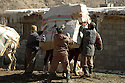 Iraq 2008.Kurdish smugglers loading an horse in Zahle <br /> Irak 2008 . Contrebandiers kurdes chargeant un cheval a Zahle