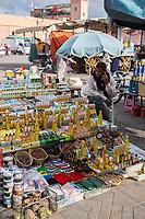 Marrakesh, Morocco.  Vendor of Argan Oil and Assorted Personal Accessories, Place Jemaa El Fna.