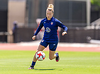 HOUSTON, TX - JUNE 8: Emily Sonnett #14 of the USWNT dribbles the ball during a training session at the University of Houston on June 8, 2021 in Houston, Texas.