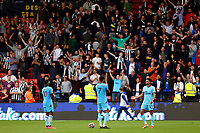 25th September 2021; Vicarge Road, Watford, Herts,  England;  Premier League football, Watford versus Newcastle; Dejected Newcastle United players thank their travelling fans after the 1-1 draw